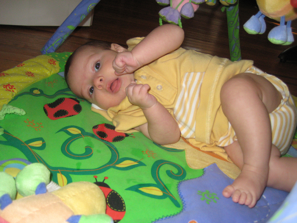 """Lay babies down on the floor and let them explore the most interesting """"toys"""" they have - their body parts and their environment!"""